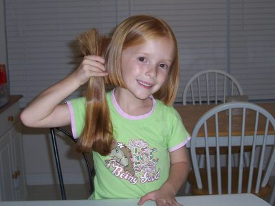 Locks of Love image of girl with her donation